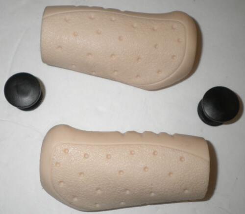 pair of cream ergonomic bicycle handlebar grips